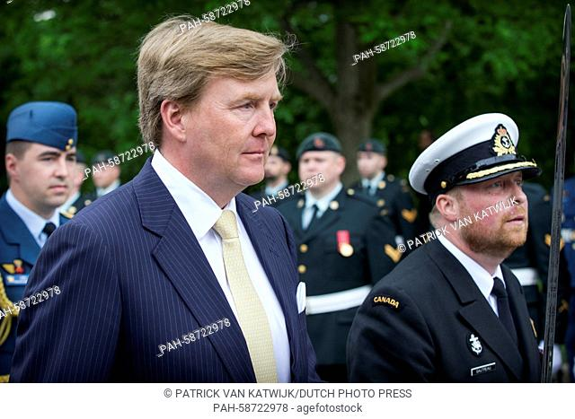 King Willem-Alexander of The Netherlands who arrive by coach attend an welcome ceremony at the Rideau Hall with Governor General Johnston and his wife in Ottawa