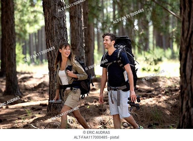 Young couple hiking in forest