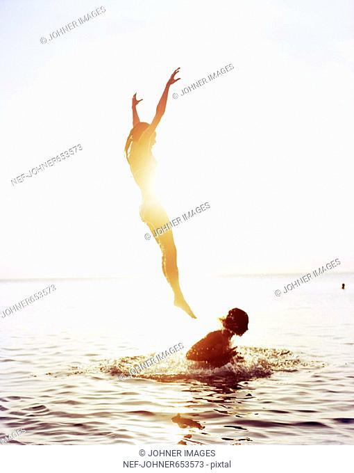 Two people having fun in the ocean, Thailand
