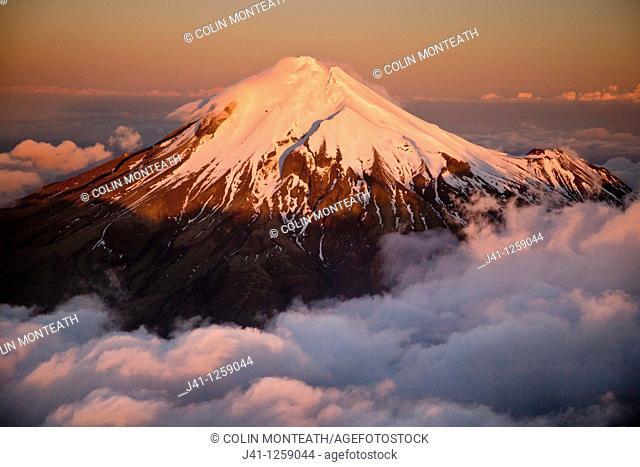 Mt Egmont / Taranaki, western flanks of dormant volcano above evening cloud, sunset, Taranaki