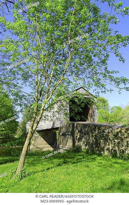 A vertical view of an old wooden covered bridge, Pennsylvania, USA