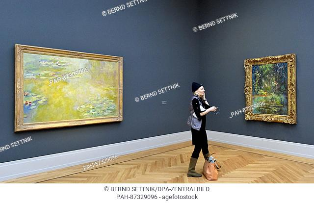 Ajournalist stands in a room with painting by Monet after the opening press conference at the Museum Barberini in Potsdam, Germany, 19 January 2017