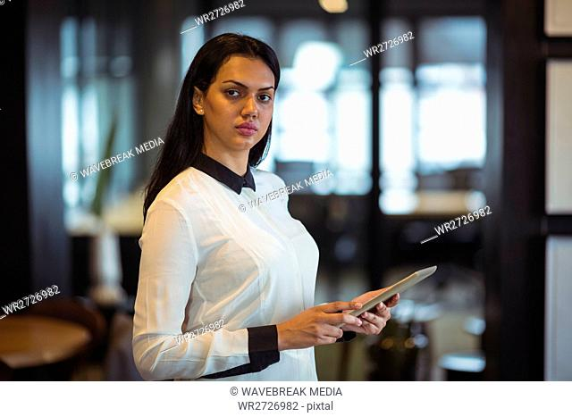 Businesswoman using digital tablet