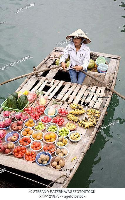 Merchants on boats in Halong Bay near Hanoi, Vietnam