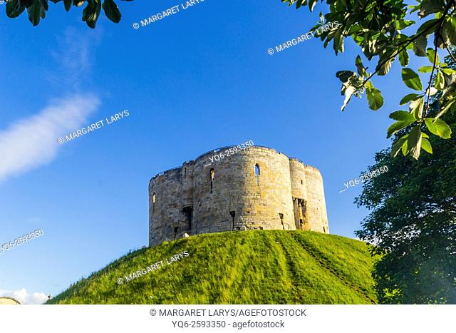 Clifford's Tower and blue sky in York, North Yorkshire, England, United Kingdom