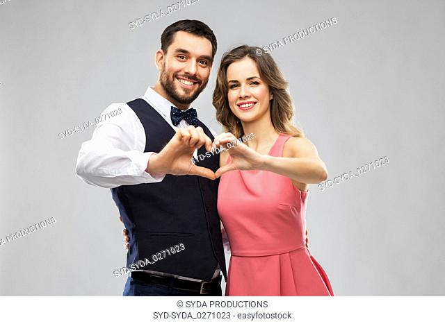 happy couple making hand heart on valentines day