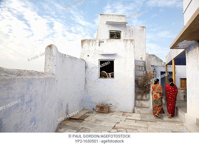 Two female devotees entering Savitri Temple in Pushkar - Rajasthan, India