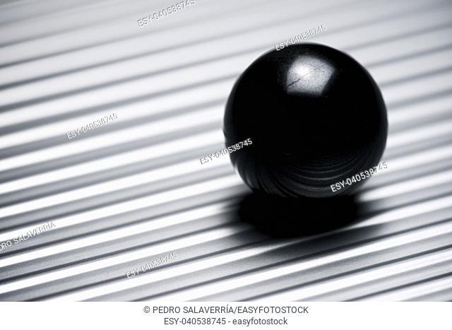 Glass ball on a metallic table