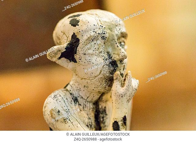 Egypt, Cairo, Egyptian Museum, statuette coming from Tell el Farkha, early Dynastic period, in hippopotamus tusk. Sitting boy