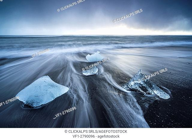 Ice blocks on the black sand beach in Jokulsarlon Glacier Lagoon, Eastern Iceland, Europe