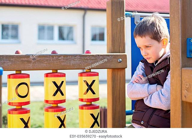 Offended boy on the playground in the school