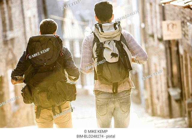 Men backpacking in city