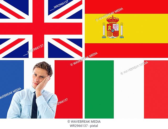 main language flags around young businessman thinking