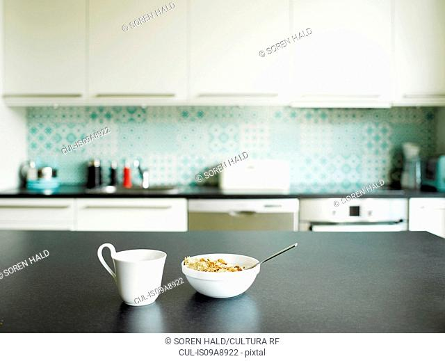 Breakfast of tea and cereal on kitchen counter