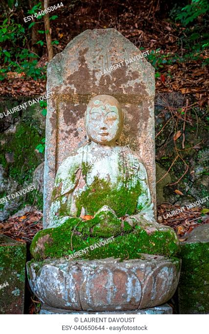 Old Buddha statue in Chion-in temple graveyard, Kyoto, Japan