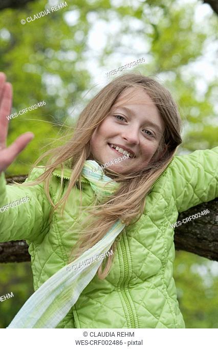 Germany, Bavaria, girl climbing on an oak