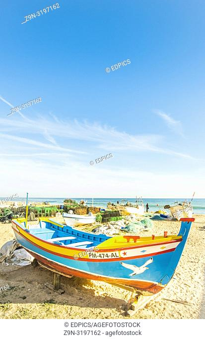traditional colourful hand-painted wooden fishing boat at fisherman's beach, praia dos pescadores, armacao de pera, algarve, portugal