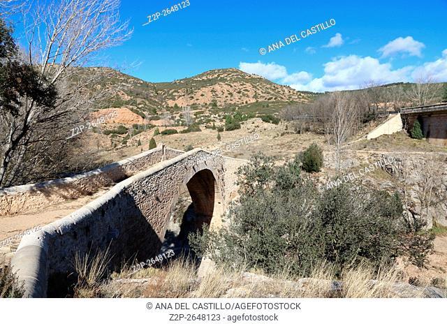 Mijares River as it passes through Teruel Spain. Fonseca medieval bridge