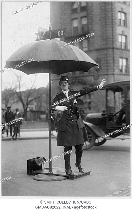 Photograph of LO King, who was a traffic policewoman, directing traffic, Washington DC, 1917. Image courtesy Harris and Ewing/US National Archives, Washington