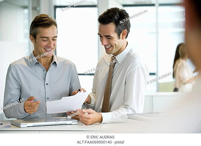 Executives discussing documents
