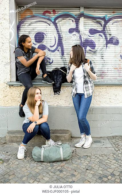 Three teenage girls hanging around