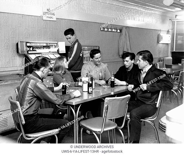 Wharton, New Jersey: January 3, 1963.Teenagers hanging out at a shop with soft drinks and listening to the jukebox