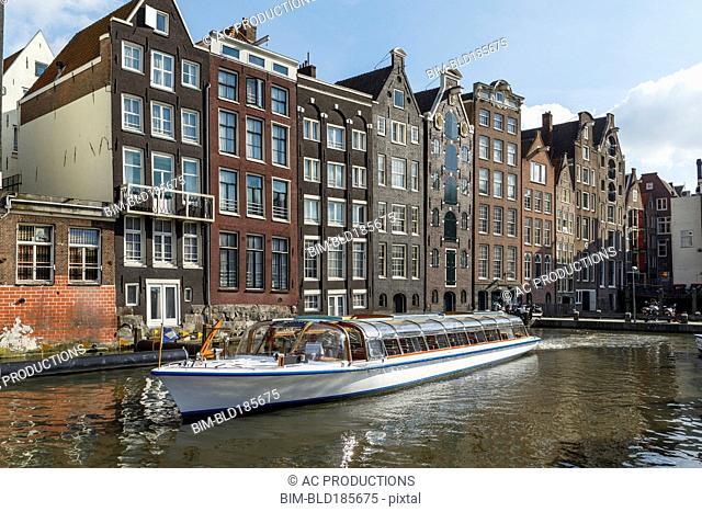 Boat on urban canal, Amsterdam, Holland