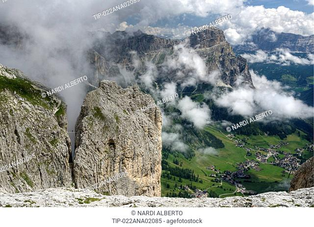 Italy Dolomites rope bridge via ferrata Tridentina between Exner rock tower and Pisciadù plateau Sella Group. bg: Sassongher Puez-Odle Natural Park and Colfosco...