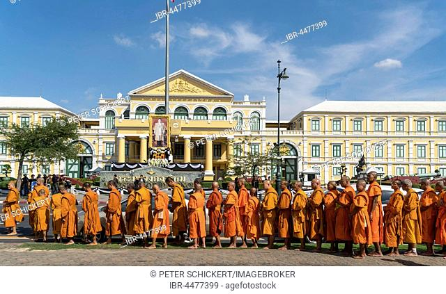 Row of monks in front of ministry of defense, Bangkok, Thailand
