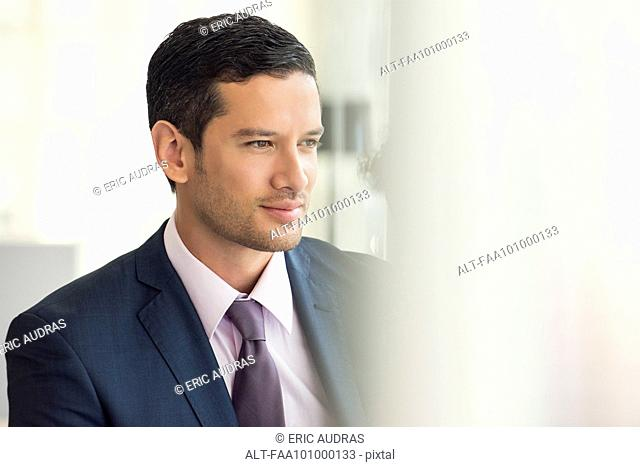 Businessman looking away in thought
