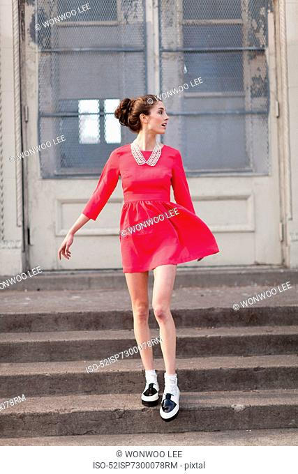 Woman walking on steps