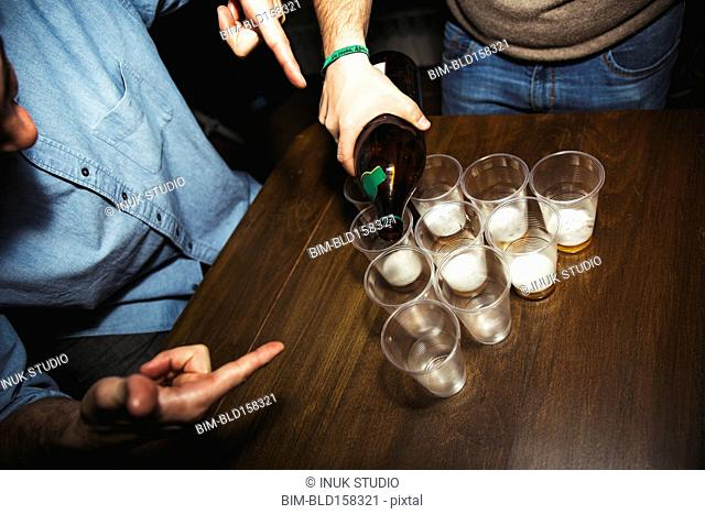 Man pouring drinks at party