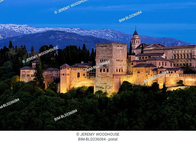 Illuminated buildings at dusk, Granada, Andalucia, Spain