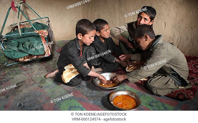 boy eating in Kabul, Afghanistan