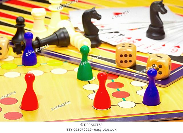 Photo shows a closeup of a various board games including chess and cards