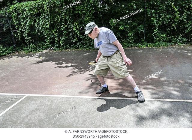 Washington DC USA Older man playing tennis, retired, exercise