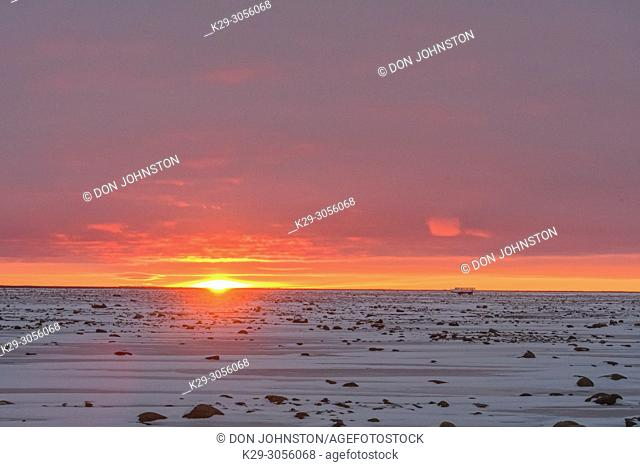 Sunset skies over Hudson Bay at freeze-up, Wapusk NP, Cape Churchill, Manitoba, Canada