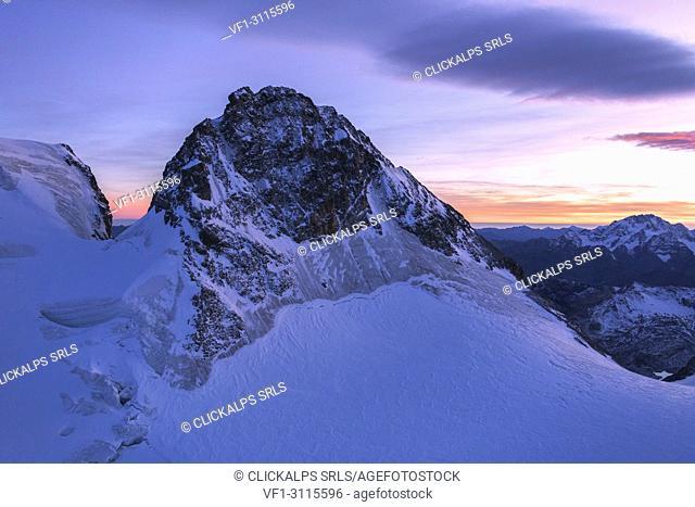 Aerial view of the snowy peak of Cresta Guzza towards Piz Bernina, Valmalenco, Lombardy, border of Italy and Switzerland