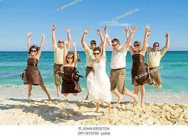 akumal, mexico, a bride and groom on the beach with their wedding party