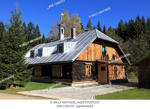 restored old wooden house built in typical Bohemian style near the Czech border at the foothills of the mountain Great Arber at Bayerisch Eisenstein