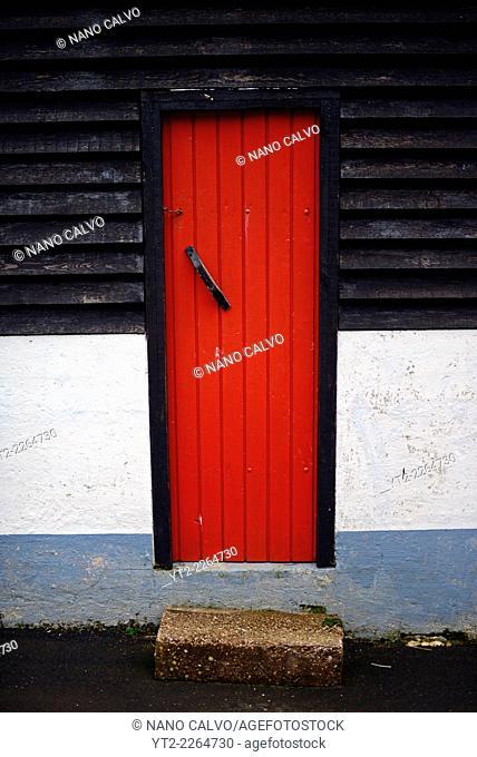 Red door in Trøllanesi, Kalsoy, Faroe Islands