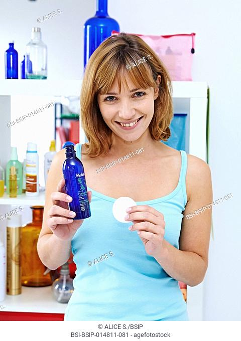 Woman using witch hazel floral water