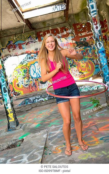 Teenage girl hula hooping