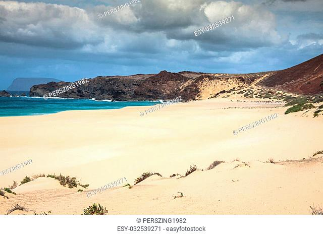 A view of Playa de Las Conchas, a beautiful beach on La Graciosa, a small island near Lanzarote, Canary Islands, in the middle of the Atlantic Ocean