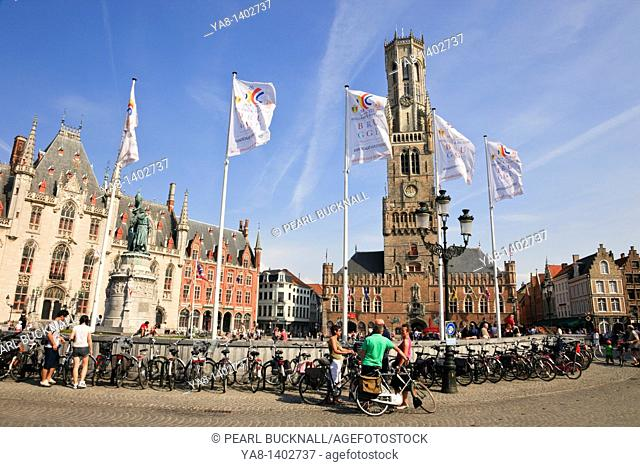 Markt, Bruges, Belgium, Europe  Bicycles parked in the historic market square with Belfy bell tower beyond