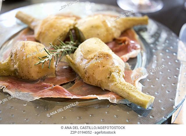 Parma Ham and Boiled Artichokes on plate Spain