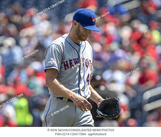 New York Mets starting pitcher Zack Wheeler (45) returns to he dugout after a rough first inning where he gave-up four runs against the Washington Nationals at...