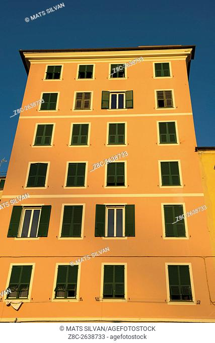 Old tall building in a sunny day with blue sky in Genoa, Italy