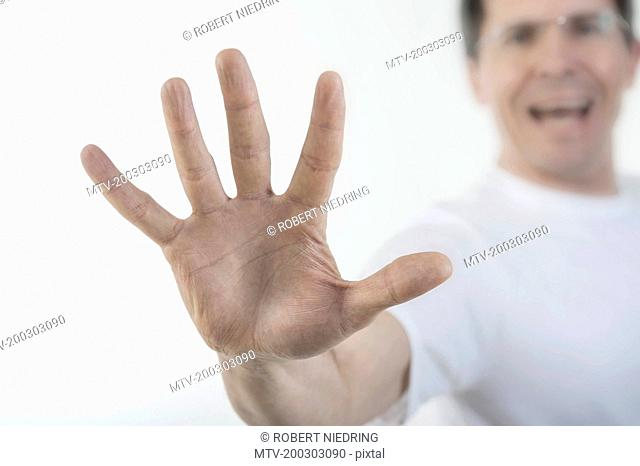 Close-up of man's hand making stop gesture, Bavaria, Germany