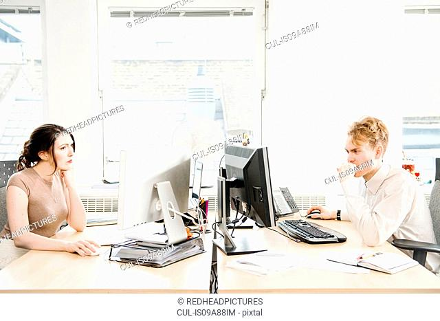 Two office workers using computers